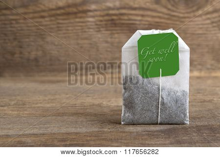 Teabag On Wooden Background, Get Well Soon