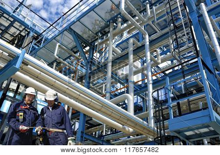 oil and gas workers inside refinery industry