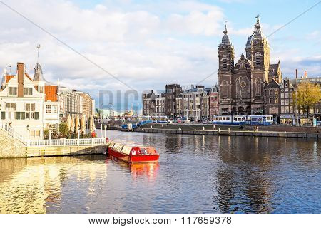 City scenic from Amsterdam in the Netherlands with the St. Niklaas church