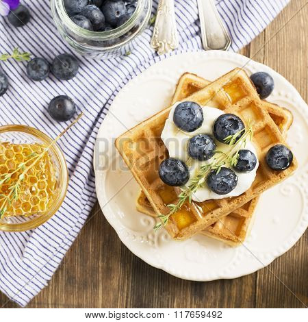 Homemade fresh crispy waffles for breakfast with  blueberries