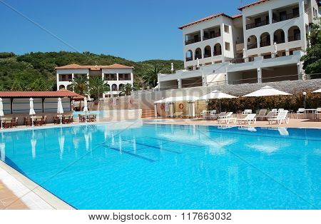 Pool And White Buildings In Greek Hotel.