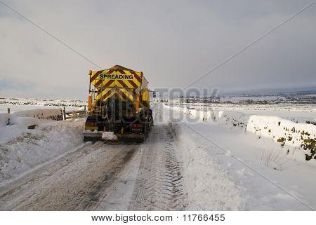 Snowplough clearing road
