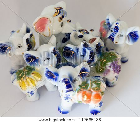 Symbol Of Seven Elephants Figurines On A White Background, Feng Shui
