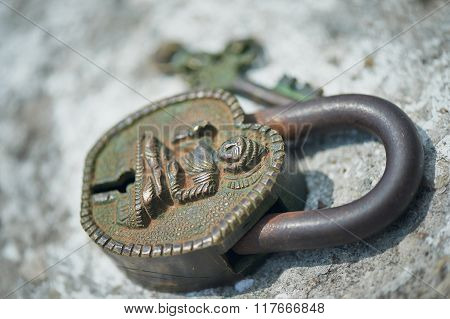 Ancient Indian key lock, green with age