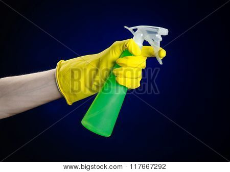 Cleaning The House And Cleaner Theme: Man's Hand In A Yellow Glove Holding A Green Spray Bottle For