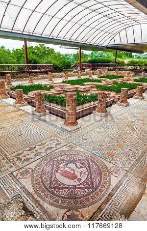 House of the Fountains in Conimbriga. View of the very ornate mosaics, peristyle, garden and pond. Conimbriga in Portugal, is one of the best preserved Roman cities on the west of the empire.
