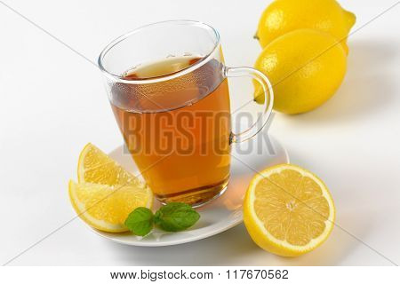 cup of black tea with lemon - close up