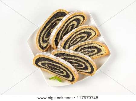 slices of poppy seed roll on white plate