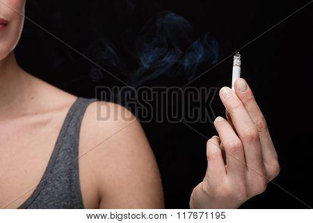 Woman Smoking Concept On Black