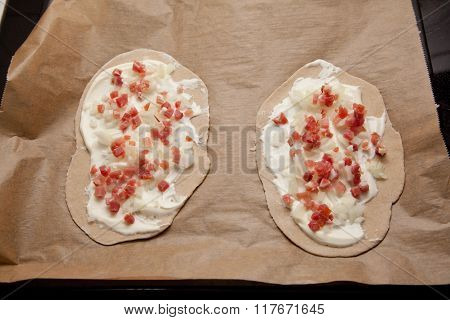 Raw Pizza Bread With Bacon Onion Sour Cream Topping On Bacing Paper