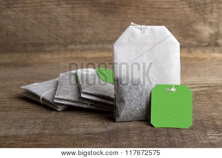 Teabags On Wooden Background