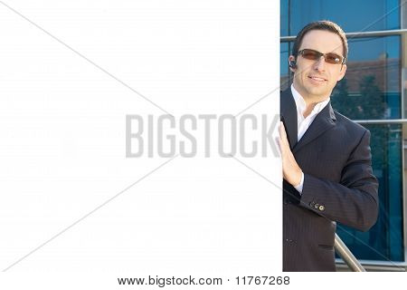 Young businessman holding a billboard