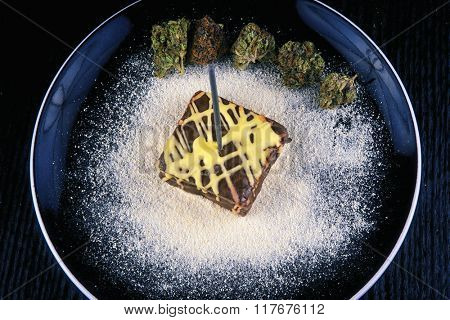 Square delicious pot brownie plate with different marijuana buds