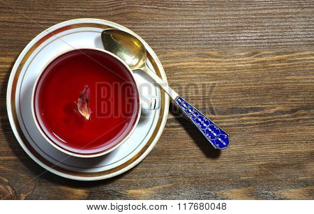 Cup Of Tea Hibiscus  On A Wooden Background
