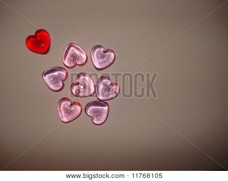 Red Valentines Heart Outside a Group of Pink Hearts