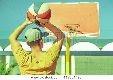 Young Handsome Guy Playing Basket On The Beach - Healthy Lifestyle Sport Recreation Concept