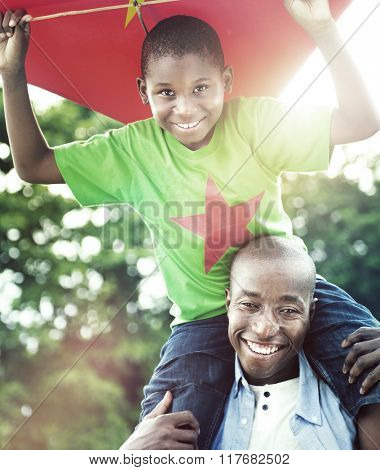 Father Son Playing Kite Summer Fun Concept