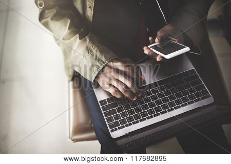 African Businessman Using Digital Laptop Smart Phone Concept