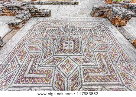 Complex and elaborate Roman tessera mosaic pavement in the House of the Swastika. Conimbriga in Portugal, is one of the best preserved Roman cities on the west of the empire.