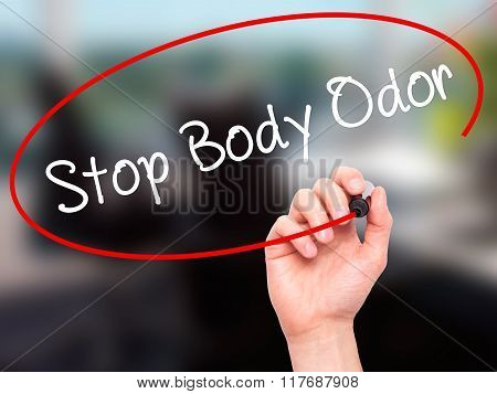 Man Hand Writing Stop Body Odor With Black Marker On Visual Screen.