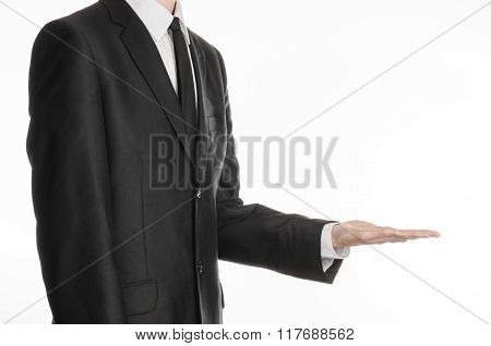 Businessman And Gesture Topic: A Man In A Black Suit And Tie Holding His Hand In Front Of Him Isolat