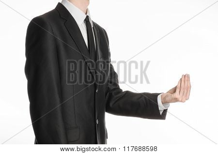 Businessman And Gesture Topic: A Man In A Black Suit And Tie Holding His Hand In Front Of Him And Sh