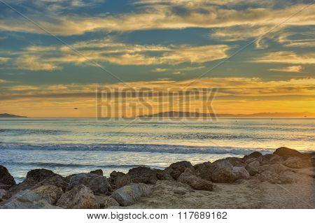 Golden sunset over shiny ocean water.