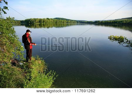 man fishing on the lake.