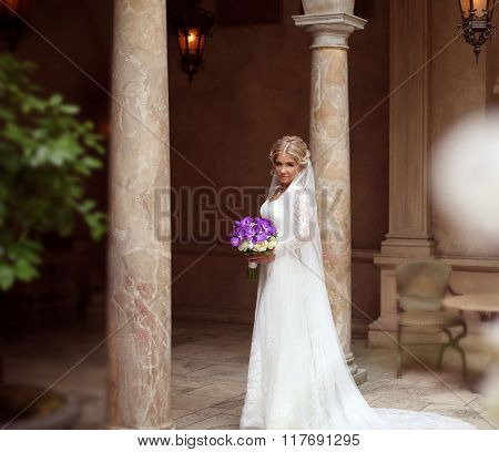 Beautiful Bride Portrait In Wedding Dress, Attractive Young Woman With Bouquet Of Flowers Between Ma