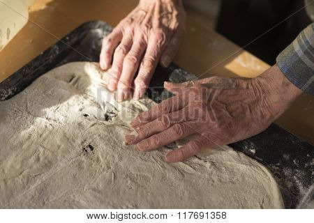 Woman Stretching Raw Pizza Crust Dough In Pan