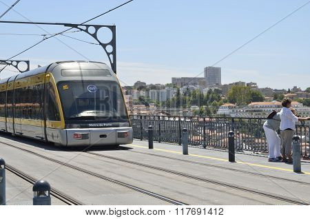 Tram Passing By The Dom Luiz Bridge