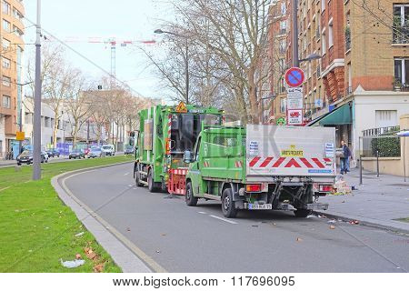 Paris, France, February 6, 2016: garbage truck in Paris, France