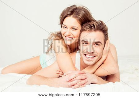 In Honeymoon Cheerful Young Couple In Love Embracing In The Bedroom