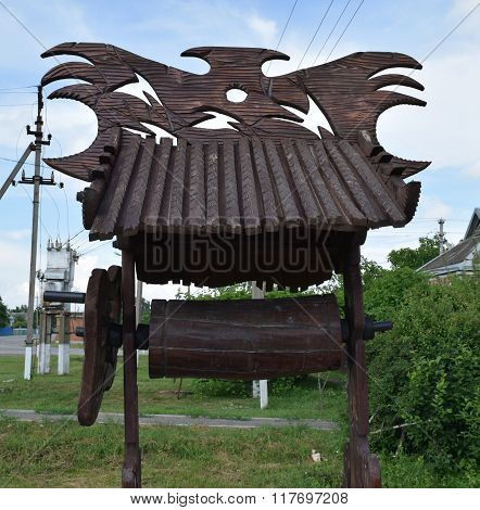 Wooden well for yard decorations. Wooden decorations.