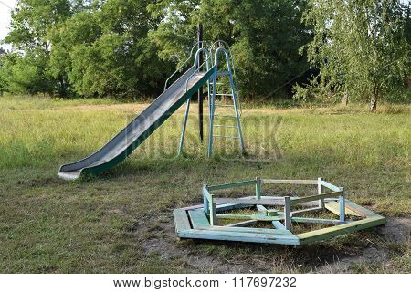 Children playground. Swings and a slide to slide.