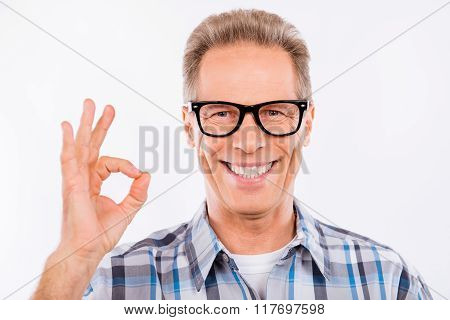 Handsome Happy Aged Man In Glasses Gesturing Ok