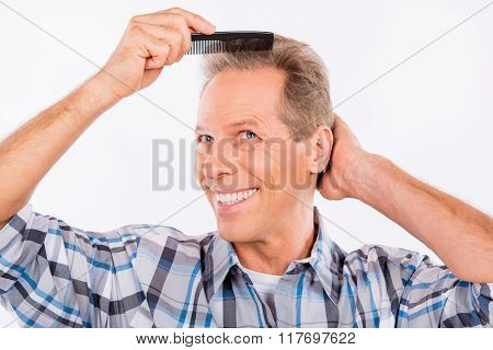 Handsome Happy Aged Man Combing His Hair