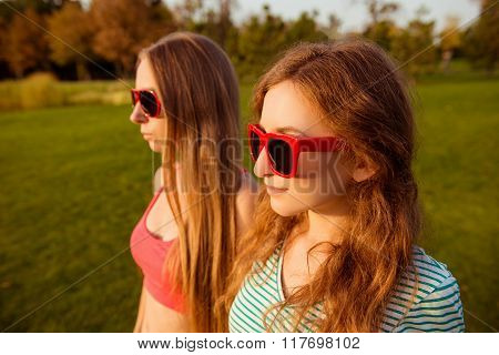 Two Sexy  Girls With Red Glasses