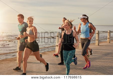 Young People Running By The Sea