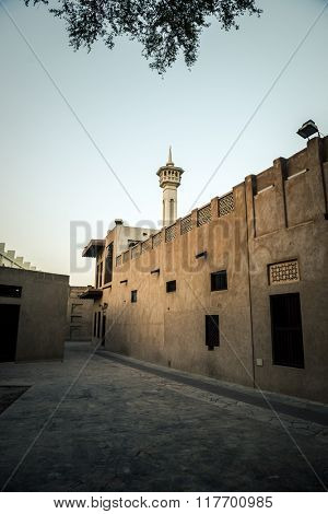 View of a mosque minaret and an old historical building.