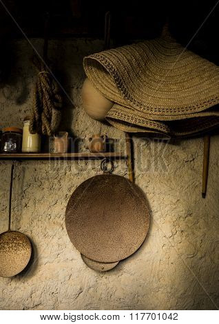 Few ancient islamic kitchen utensils hanging on the wall. Middle eastern bedouins lifestyle.