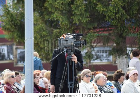Russia Poltavskaya village - 9 May 2015: Video operator removes the concert. Concert to celebration of a Victory Day in Poltava.