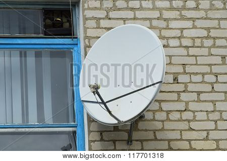 Satellite Antenna On The Wall Near  Window