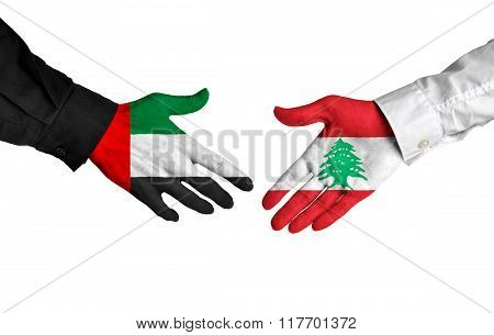 United Arab Emirates and Lebanon leaders shaking hands on a deal agreement