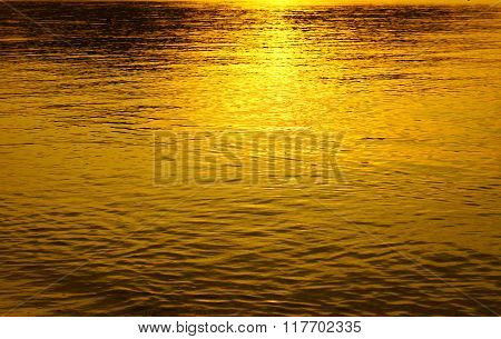 Sunset reflection in water gold lite
