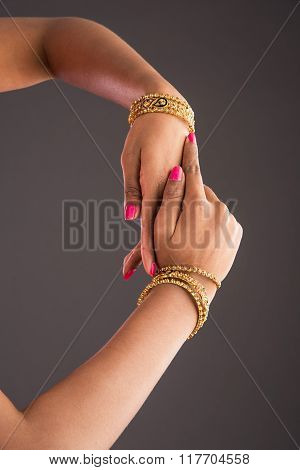 gold bangles in hand, graceful poses of girls hand wearing gold bangles, designer gold bangles and h