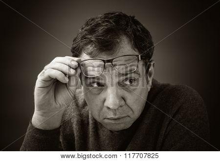 Serious man in glasses.