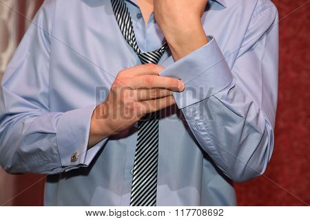 The Groom Wears Cuff Links On The Sleeves