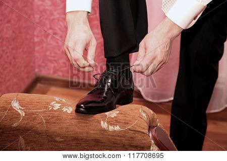 The Groom Wears Wedding Shoes