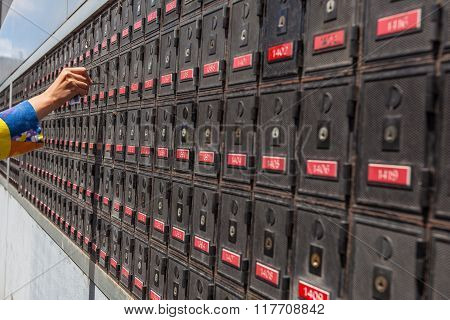 Woman Hand Unlocking Po Box